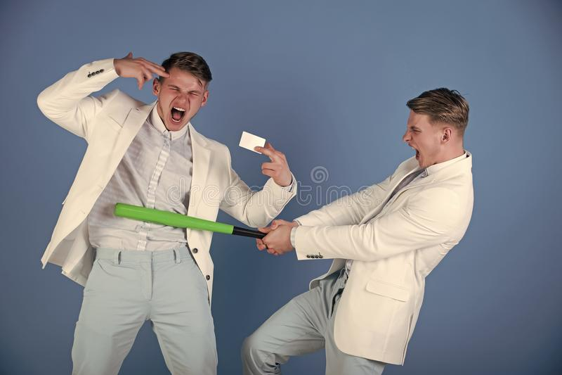 Businessman batting rival with baseball bat stock photography