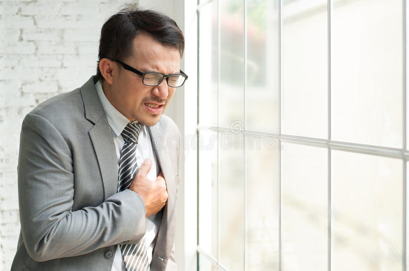 Businessman be ill and heart failure stock image