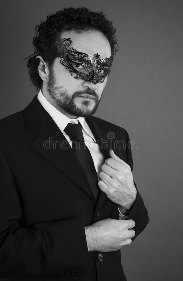Businessman with beard and black suit on artistic background