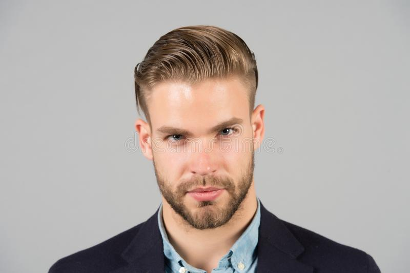 Businessman with beard and mustache on unshaven face. Bearded man with stylish hair or haircut. Beard grooming and hair care in ba. Rbershop. Business fashion royalty free stock photo
