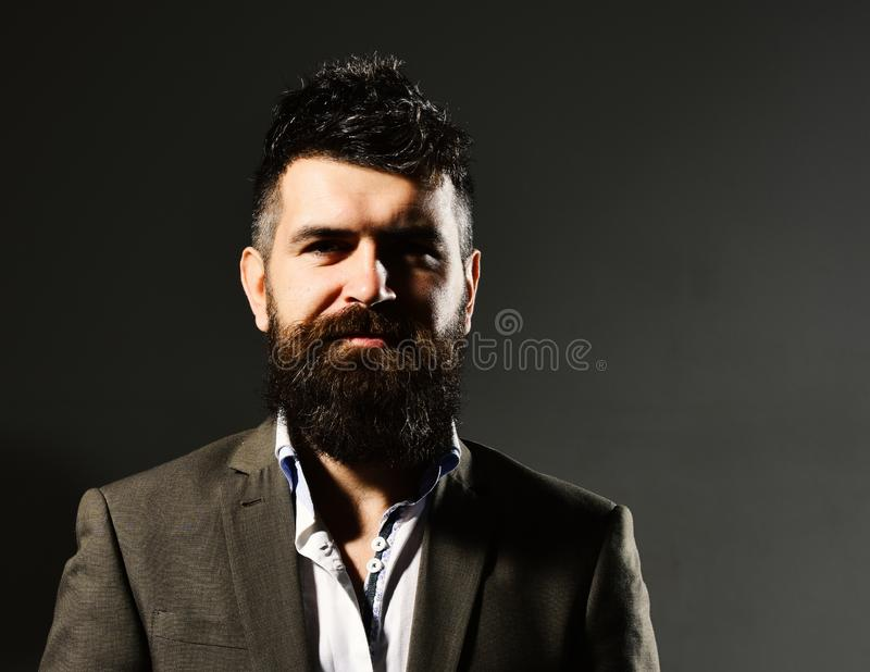 Businessman with beard and spiky hair in formal wear. Business confidence and elegance concept. Man in suit with royalty free stock photography