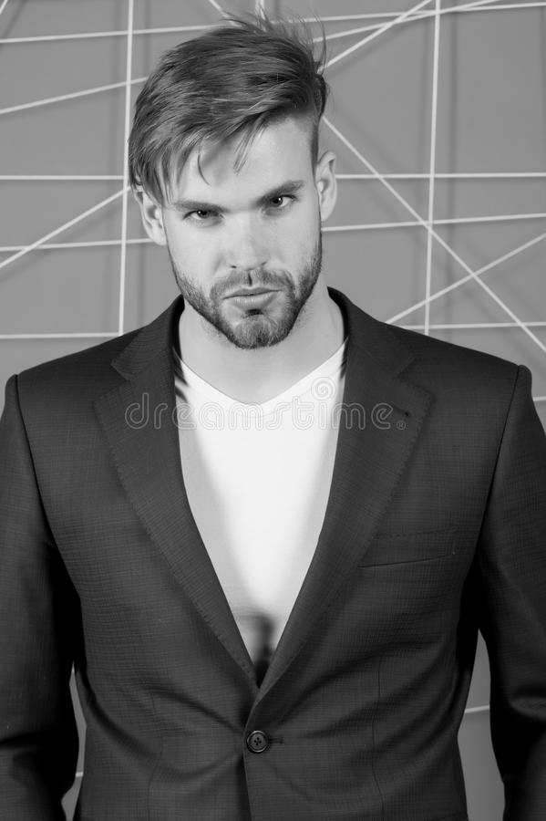 Businessman with bearded face, haircut. Man in formal suit jacket, tshirt, fashion. Mens fashion style and dress code. Busin stock photography