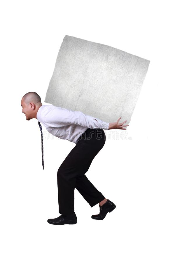 Businessman Bearing Heavy Load on His Back, Side View Profile. Portrait of businessman under pressure, walking while bearing heavy load on his back, side view royalty free stock photos