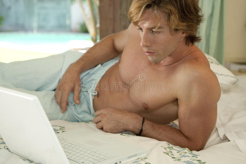 Download Businessman Bed With Laptop PC Stock Image - Image: 24687225