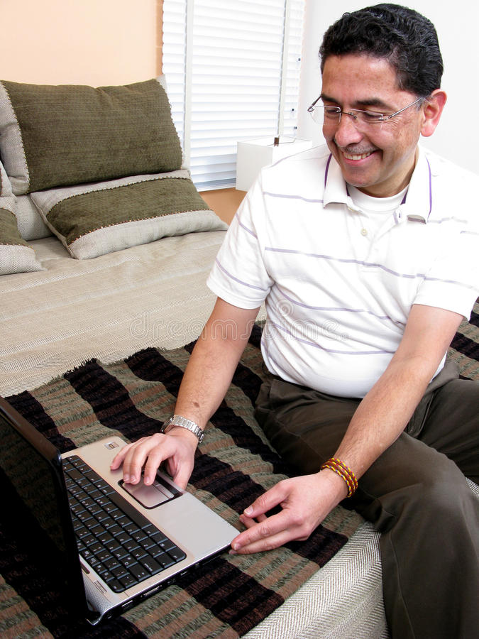 Businessman at bed looking at computer