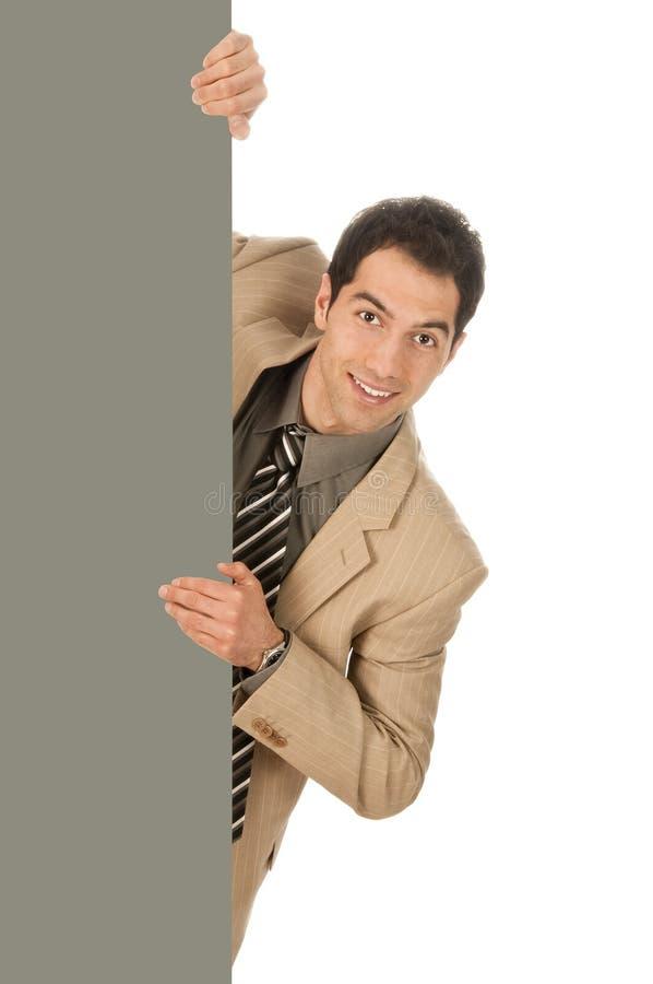 Businessman behind a shield stock photos