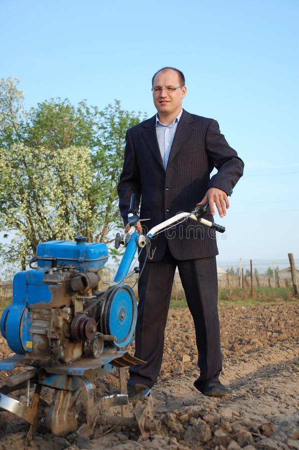 The Businessman Behind A Tractor. Royalty Free Stock Photos