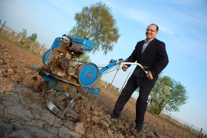 Download The Businessman Behind A Tractor. Stock Photo - Image of business, kitchen: 14216562