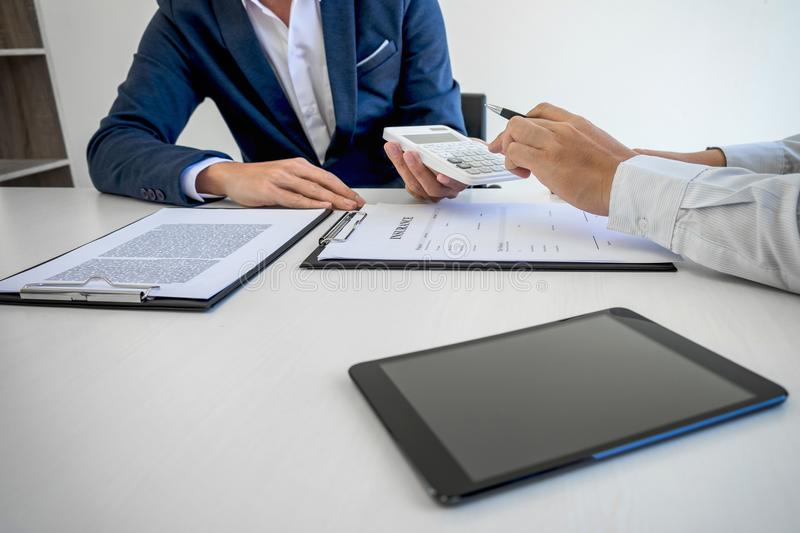 Businessman being analysis and making the decision a car insurance policy, Agent man is holding the calculator and waiting for hi. S reply to finish royalty free stock image