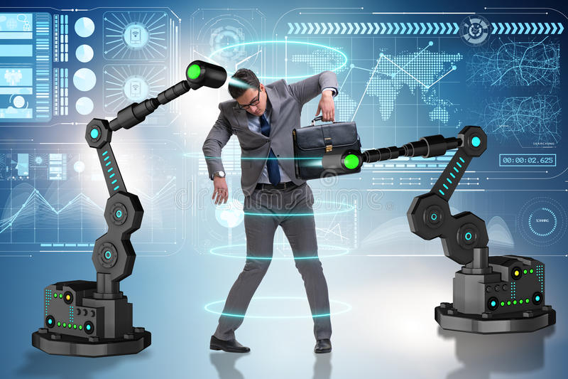 The businessman being manipulated by robotic arms stock image