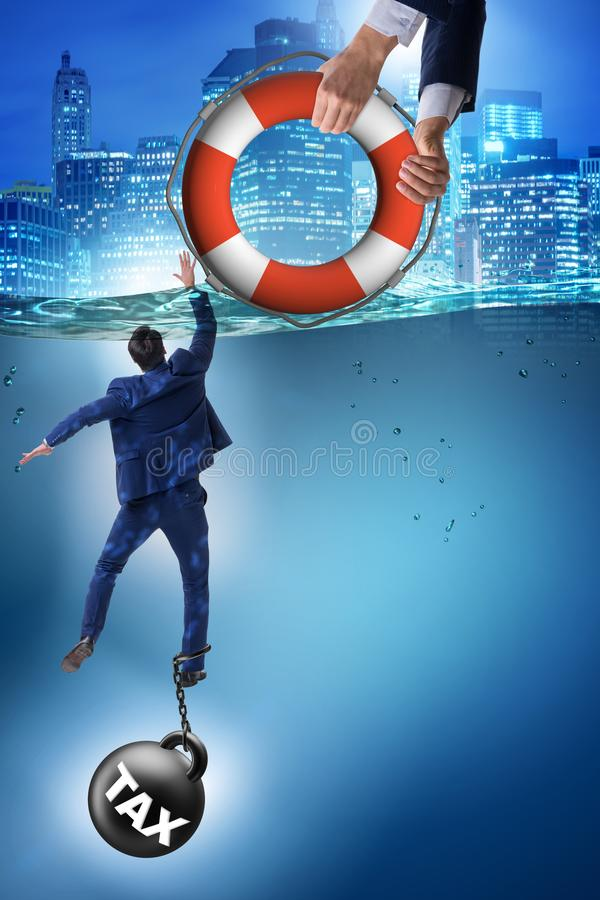 The businessman being saved from high taxes. Businessman being saved from high taxes royalty free stock photo