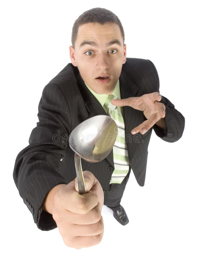Businessman Bending Spoon By Mind Force Free Stock Photography