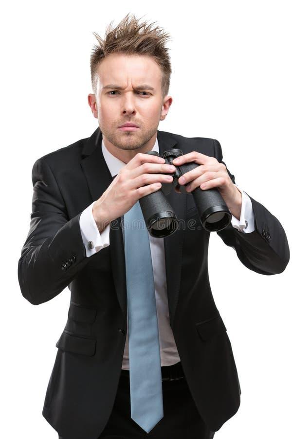 Businessman with binocular stock photography