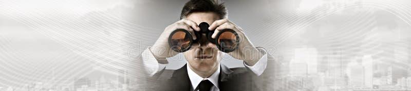 Businessman with binoculars. royalty free stock image
