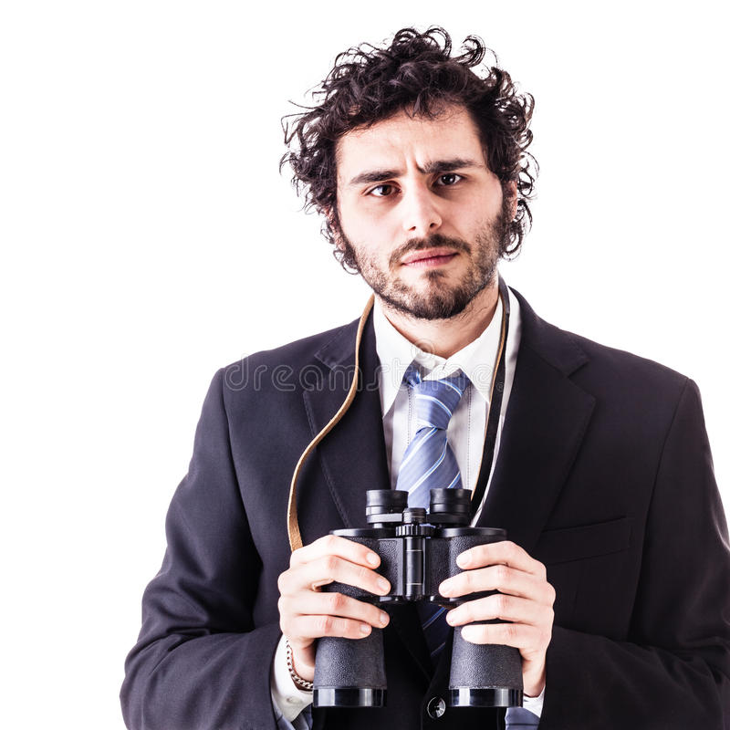 Businessman with binoculars stock image