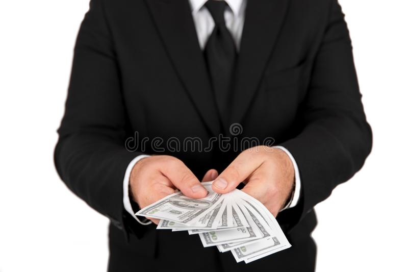 Businessman in black business suit, holding cash in hands - United stage dollar bill; clipping path - Concept of the fight against stock images