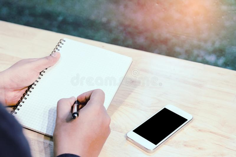 Businessman in black shirt hands holding pen pointing at business document on desk stock image