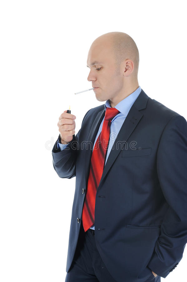 Businessman in black suit holding a cigarette royalty free stock image