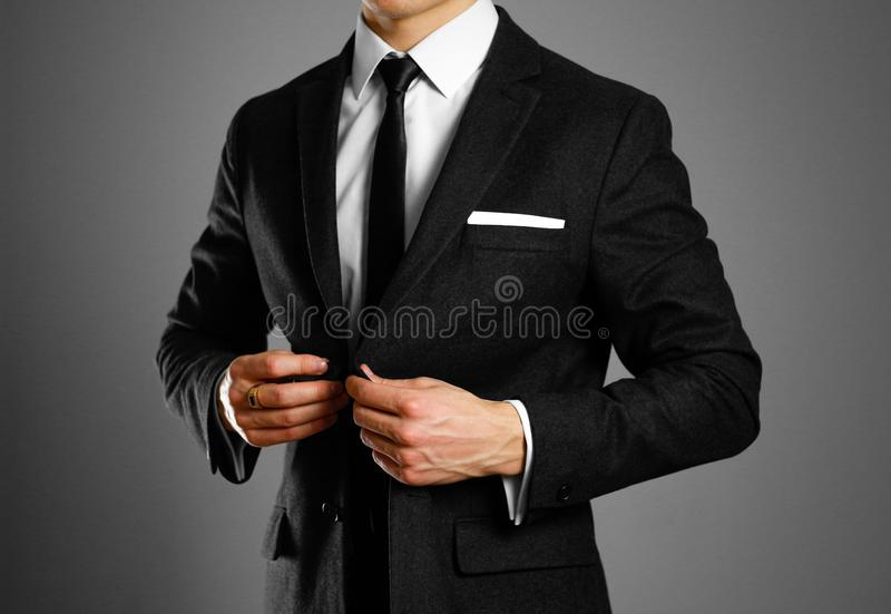 Businessman in a black suit, white shirt and tie. Studio shooting royalty free stock photo