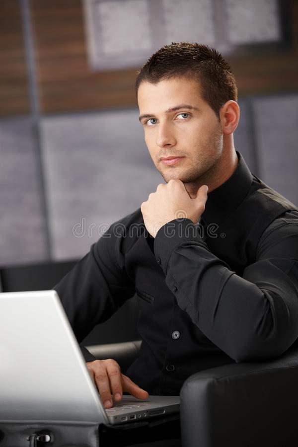 Businessman In Black Working On Laptop Royalty Free Stock Photos