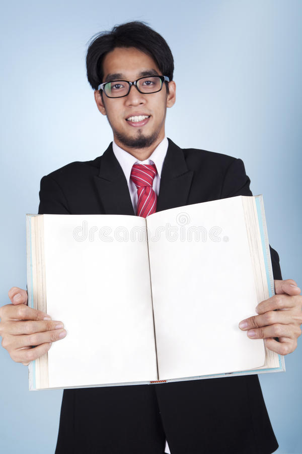 Businessman With A Blank Book Royalty Free Stock Photography