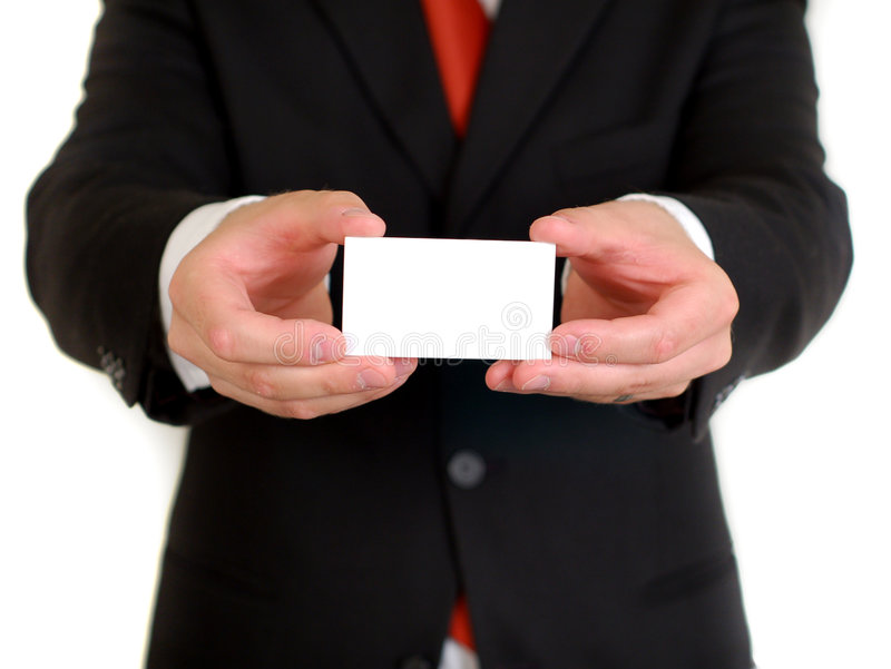 Businessman with blank business card. A businessman with a blank business card in his hands stock photo