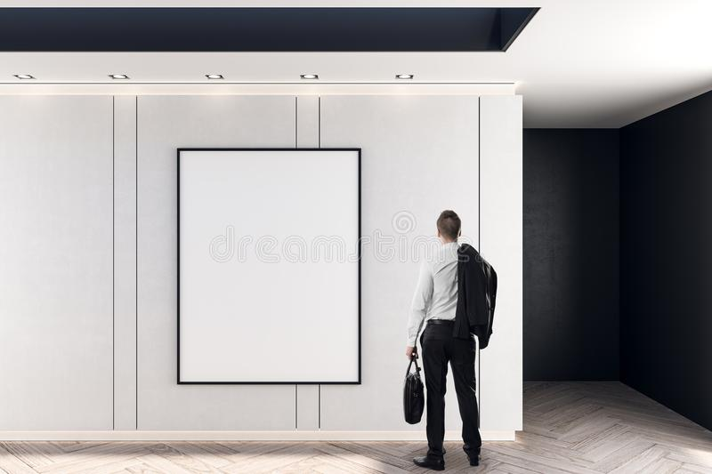 Businessman and blank poster royalty free stock image
