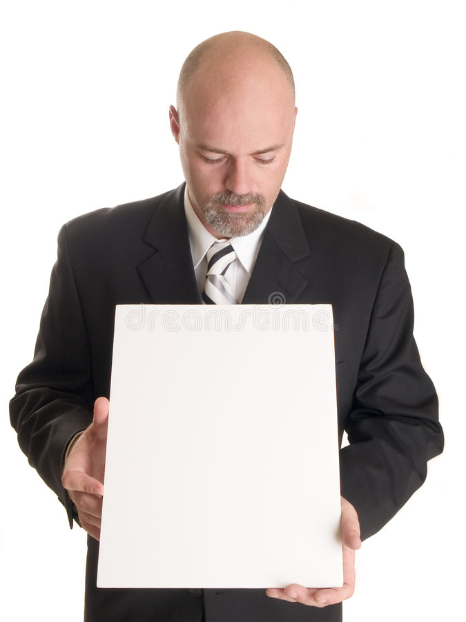 Businessman with blank sign stock image