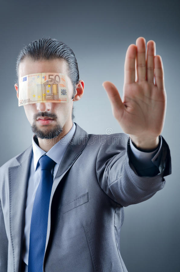 Businessman blinded with money. On the dark royalty free stock photos
