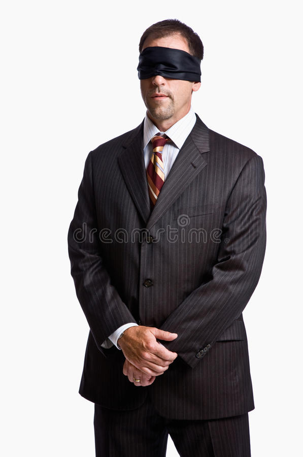 Businessman in blindfold royalty free stock photography