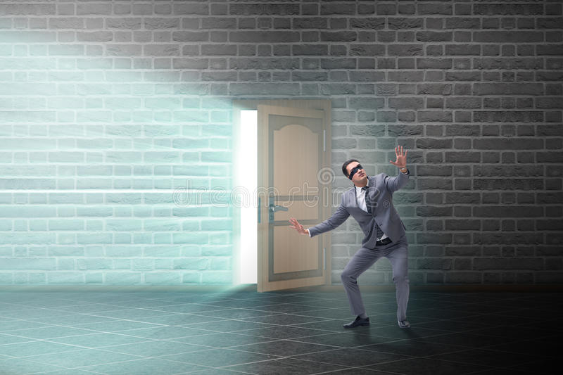 The businessman blindfold in uncertainty concept. Businessman blindfold in uncertainty concept royalty free stock photos