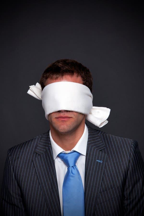 Businessman blindfolded royalty free stock photography