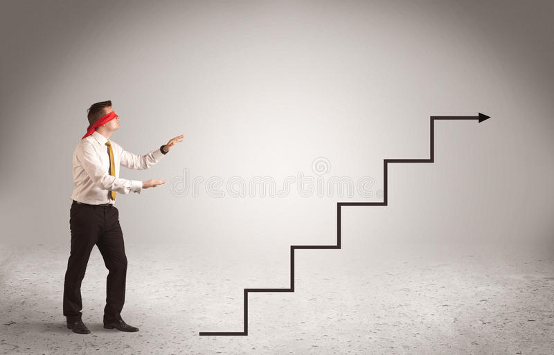 Businessman with blindfolds. A male office worker standing blindfolded and confused with arrows pointing in different directions concept stock photo