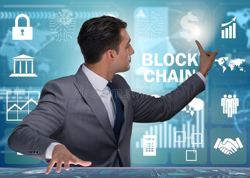 Businessman in blockchain cryptocurrency concept. The businessman in blockchain cryptocurrency concept stock photo