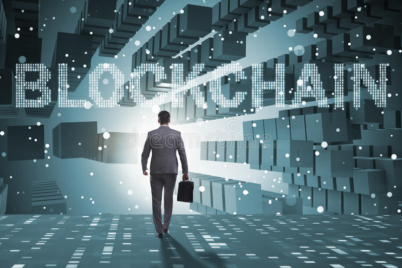 The businessman in blockchain cryptocurrency concept stock photo