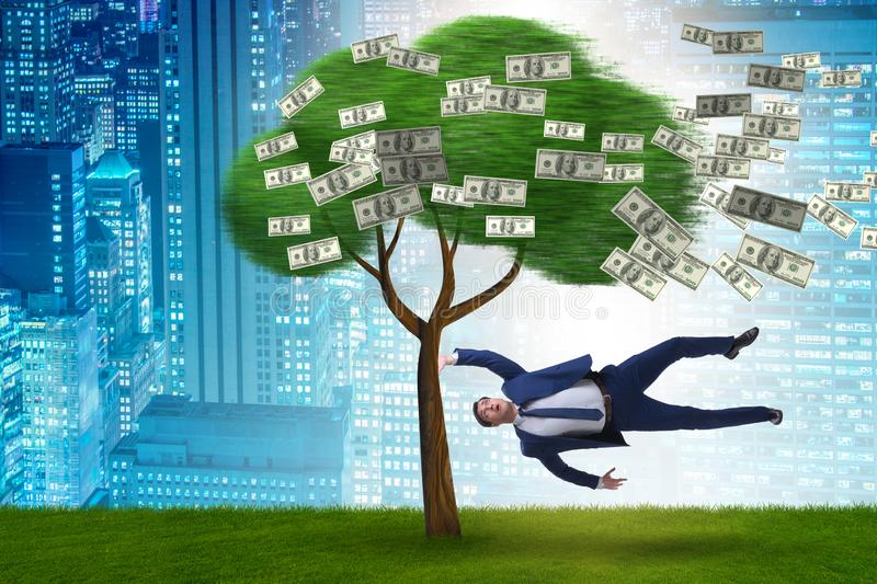 Businessman blown away from the money tree royalty free stock images