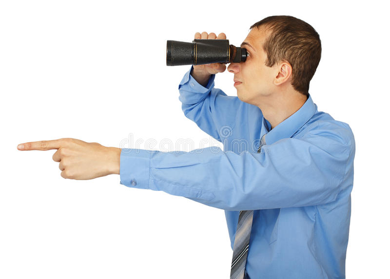 Businessman in blue shirt looking with his binocular and pointin stock images
