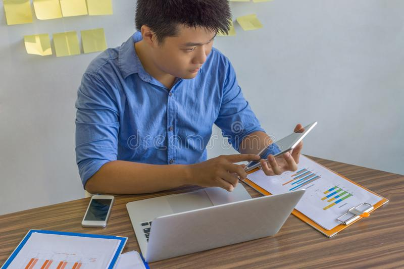 Businessman in blue shirt using tablet for work royalty free stock photo