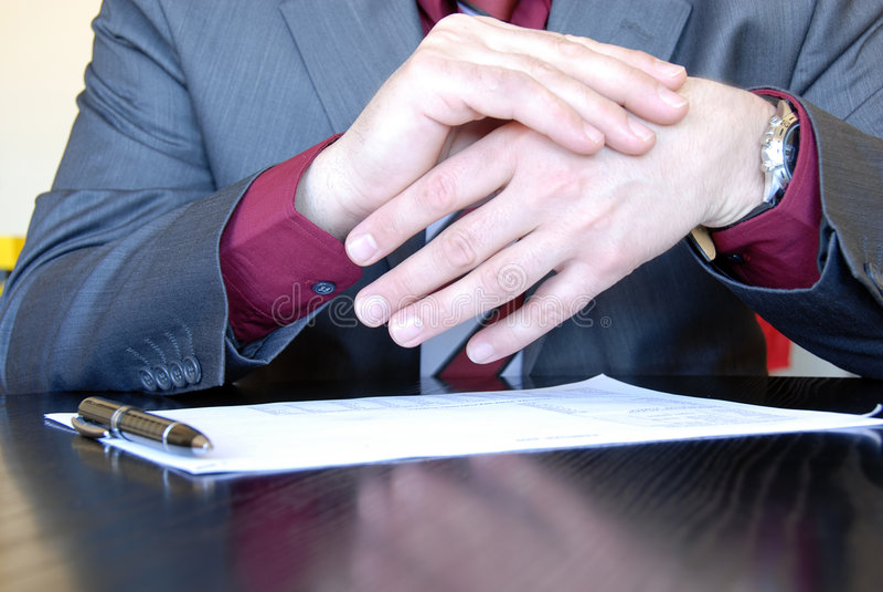Businessman body language. Businessman hands on desk gesticulation stock photos