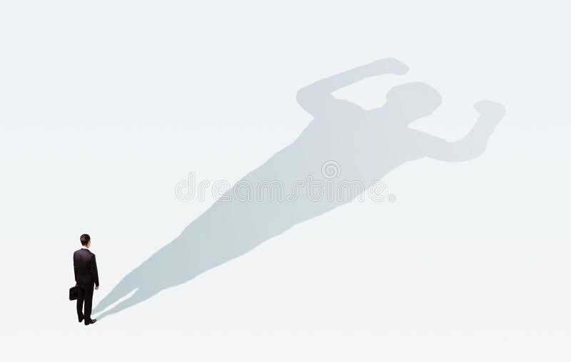 Businessman with bodybuilder shadow royalty free stock image
