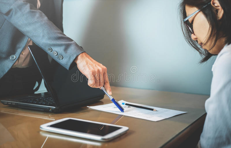 Businessman or boss complain to Businesswoman or employee at off royalty free stock images