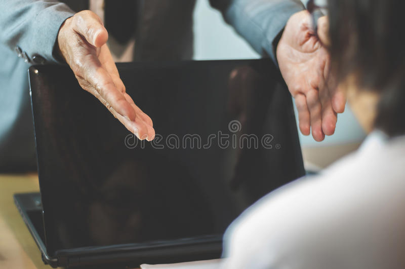 Businessman or boss complain to Businesswoman or employee at off stock photos