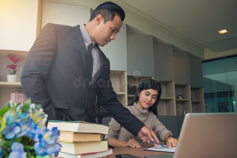 Businessman boss leader coaching and teaching secretary on the j stock image