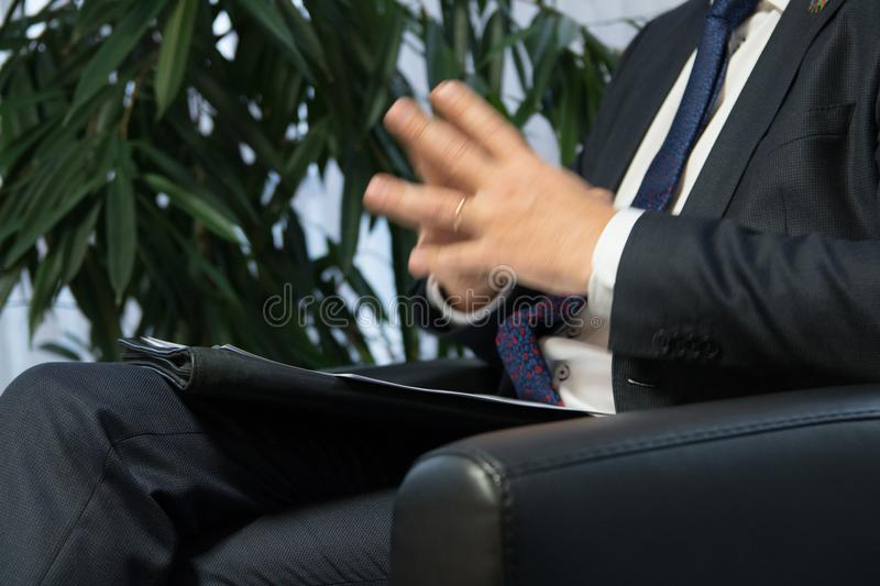 Businessman boss or politician giving interview. Close up shot stock photography