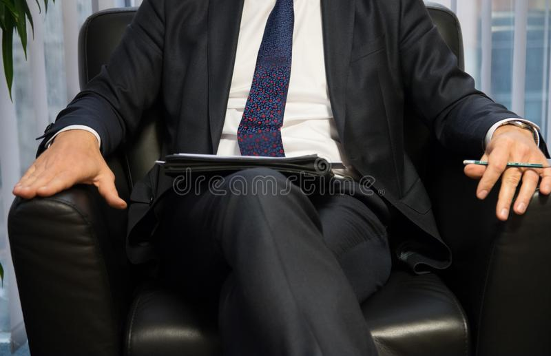 Businessman boss or politician giving interview. Front view. Businessman boss or politician giving interview. Front view close up shot stock photo