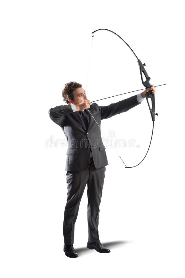 Businessman with bow and arrow stock photography