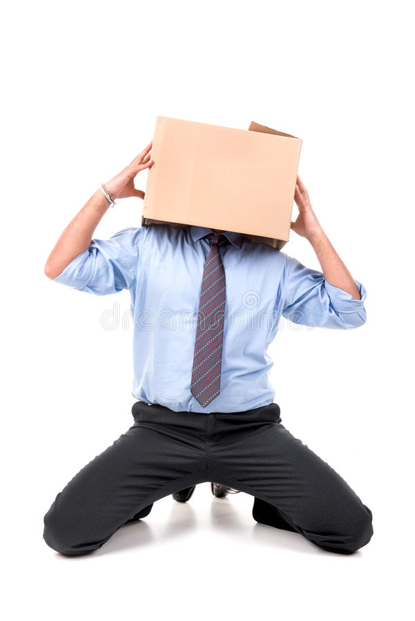 Businessman with box head stock image