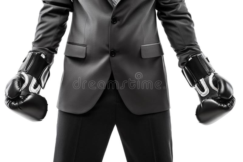 Businessman boxer in black suit wearing sport boxing gloves royalty free stock images