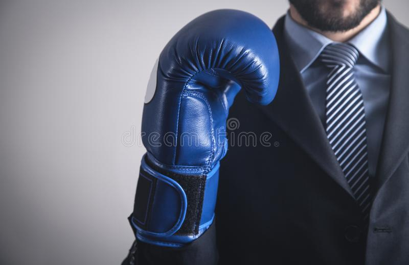 Businessman in boxing glove. Business, Power, Sport stock photos