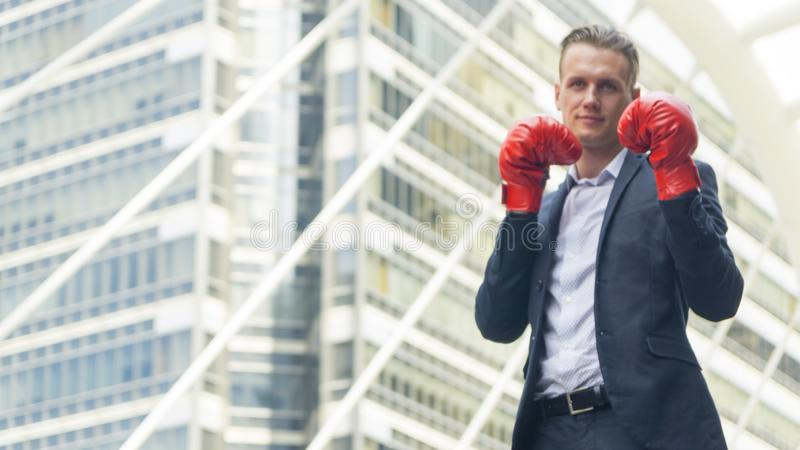 Businessman with boxing glove hand stand at outdoor royalty free stock photo